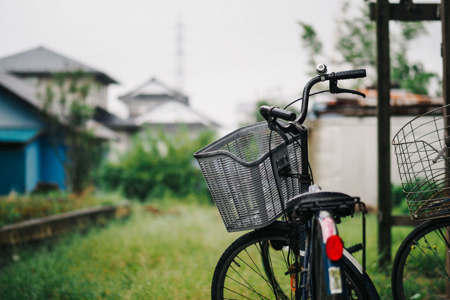 Close-Up Of Bicycle In Suburban Backyard Architecture Backyard Basket Bicycle Bicycle Basket Building Exterior Built Structure Close-up Colour Image Day Focus On Foreground Garden Grass Horizontal House Japan Land Vehicle Mode Of Transport No People Outdoors Stationary Transportation