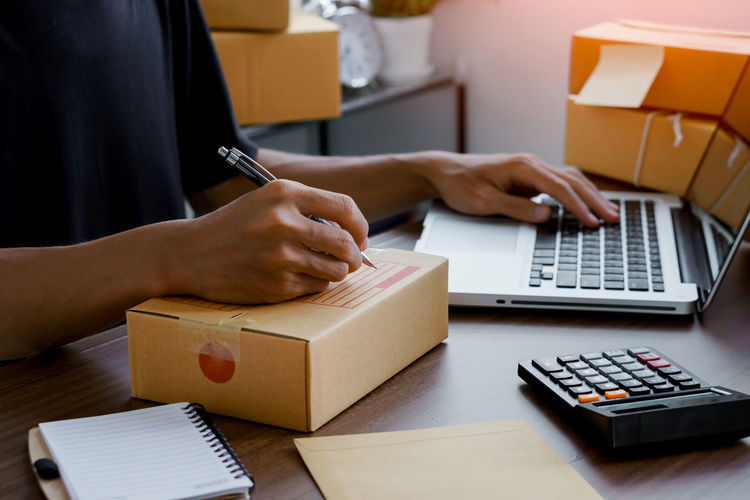 Online seller write customer address to delivery to customer.