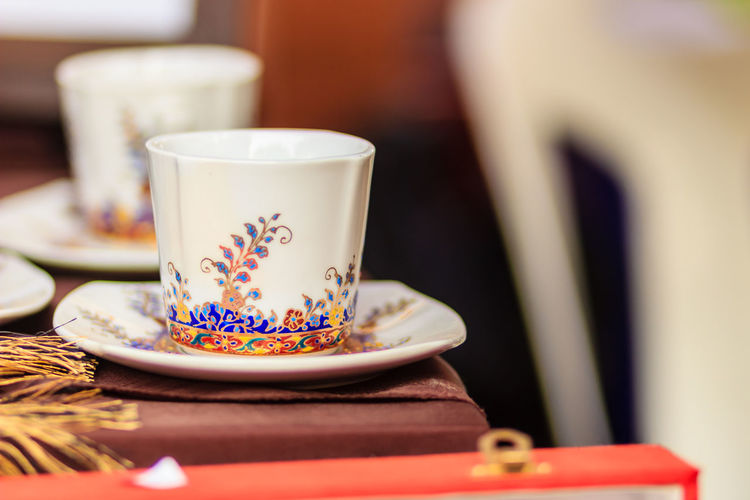 Close-up of tea cups on table