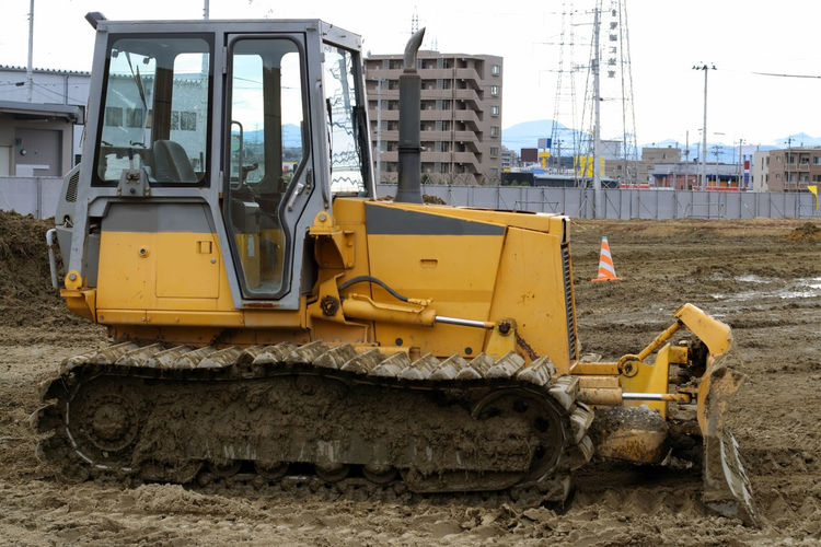 Image of a bulldozer in a construction area of a city. Construction Site Construction Industry Land Vehicle Construction Machinery Earth Mover Bulldozer Machinery Construction Vehicle Construction Equipment Bulldozer