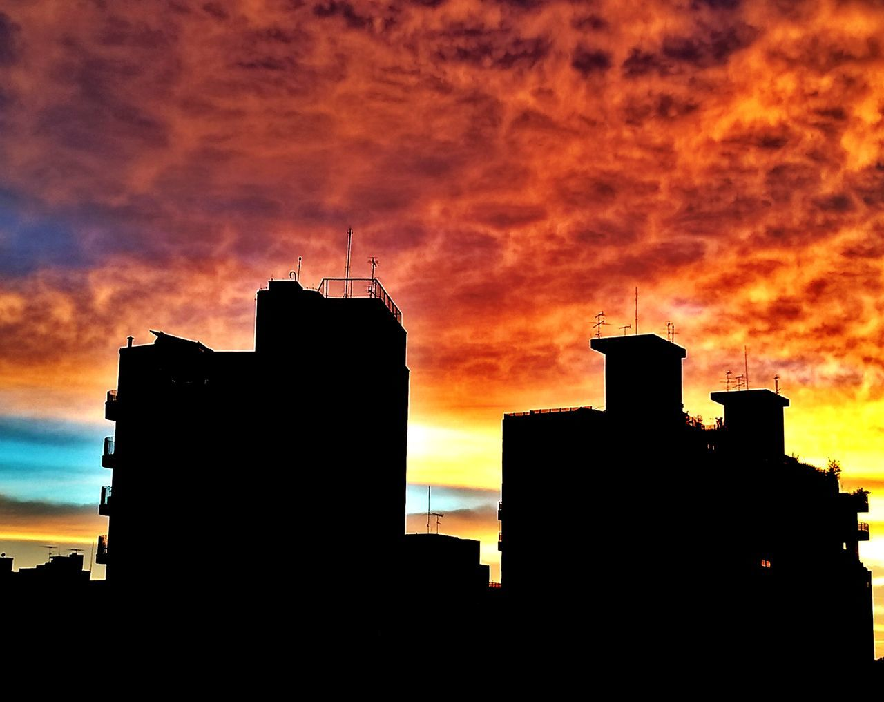silhouette, sunset, architecture, orange color, building exterior, built structure, sky, cloud - sky, building, nature, no people, outdoors, city, dramatic sky, residential district, beauty in nature, sunlight, low angle view, dark, factory, romantic sky