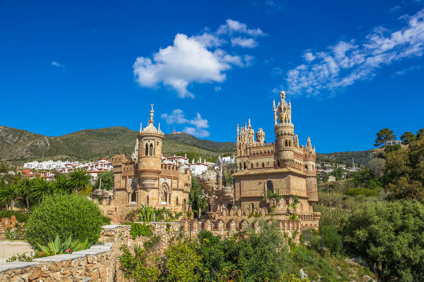 Benalmadena, Andalusia, Spain - circa April, 2016: The famous Castillo de Colomares is a monument similar to a fairytale castle, dedicated to Christopher Columbus. Andalucía Colomares Castle SPAIN Ancient Civilization Andsalusia Architecture Beauty In Nature Blue Building Exterior Built Structure Castillo Colomares Day History Mountain Nature No People Outdoors Place Of Worship Sky Spirituality Travel Destinations Tree