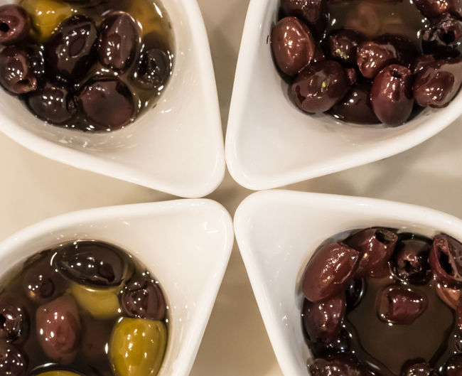 Top down view of olives in modern dishes. Olives Food And Drink Food Freshness Indoors  Olive Close-up No People Black Olive Bowl Directly Above Ready-to-eat Table Healthy Eating Indulgence
