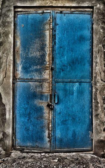 Close-up of old blue door