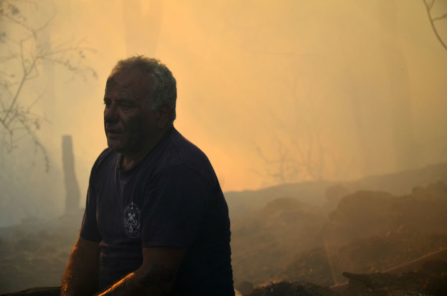 Fireman resting after putting out a forest fire in Lebanon Aftermath Disaster Fire Firefighter Fireman Forest Forest Fire Forestfire Lebanon Natural Disaster Pain Pondering Resting Sad Smoke