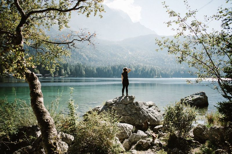 - Eibsee - Nature Rear View Beauty In Nature Tree Water Lake Lifestyles Mountain One Person Real People Outdoors EyeEm Nature Lover EyeEm Best Shots Place Of Worship People Portrait Travel Destinations Bavaria Explore Shine Mountain Range Landscape Leisure Activity Idyllic EyeEm Best Edits