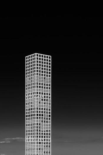 Close-up of modern building against black background