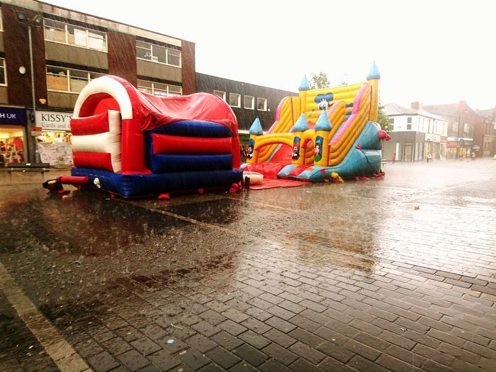 Wet Multi Colored Day Outdoors No People Water Caught In The Rain Abandoned Bouncy Castle Thunderstorm Sudden Downpour Wheres All The People The Street Photographer - 2017 EyeEm Awards