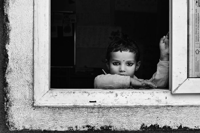 Peering from her Classroom Window at the Camera Photography Digital Nepal Child Female Young Frame Cute Black And White Photography Portrait School Education Volunteer Volunteering