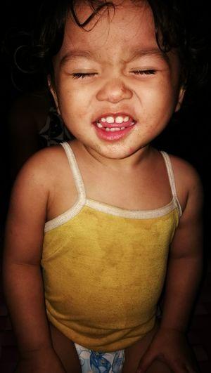 Close-up portrait of little girl