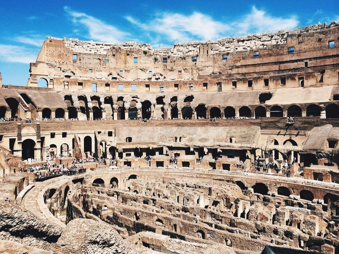 Interior of colosseum against sky