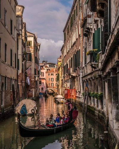 EyeEm Selects Canal Travel Destinations Gondolier Outdoors Architecture Cityscape Water Gondola - Traditional Boat City Sky People EyeEmNewHere The Week On EyeEm Nikon D700 Venezia Venice City Light Day Streetphotography Street Building Exterior