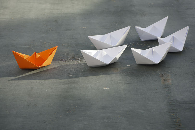 Close-up of paper boats on table