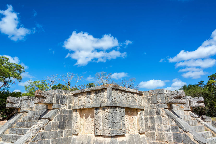 Platform of the Eagles and Jaguars with a beautiful blue sky in the ruins of Chichen Itza in Mexico Ancient Archeology Architecture Cancun Chichen Chichen Itza Chichenitza City Civilization Landmark Maya Mayan Mexican Mexico Old Pyramid Sacred Site Stone Temple Tourism Travel Unesco World Yúcatan