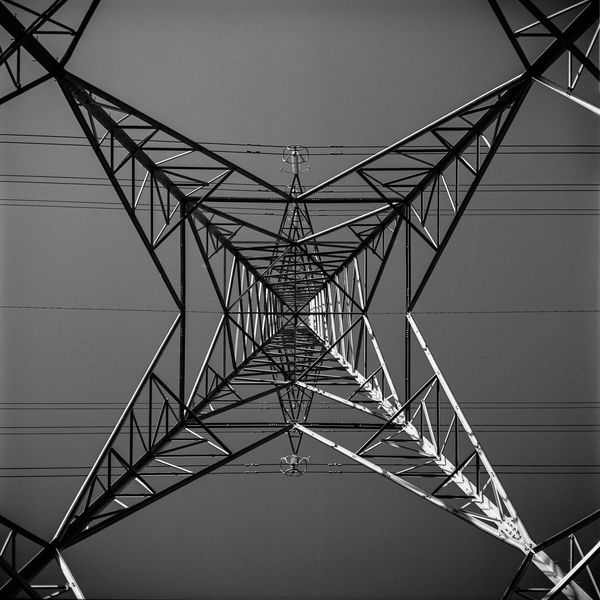 An electricity pylon near the city centre in Glasgow, Scotland. Infrared Juxtaposition Mesmerizing Architecture Balance Black And White Cable Clear Sky Connection Contrast Day Electricity  Electricity Pylon Fuel And Power Generation Girder Light And Dark Monochrome No People Outdoors Patterns Power Supply Red Filter Sky Star Symmetry