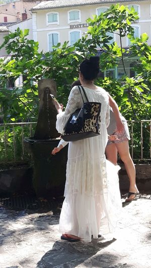 Chinese tourist in Provence, France Tourist Chinese Tourists Chinese Tourist White White Dress Fontaine-de-vaucluse Fontaune De Vaucluse Provence France Summer Thirsty  Water Drinking Waiting Full Length Tree Standing Women
