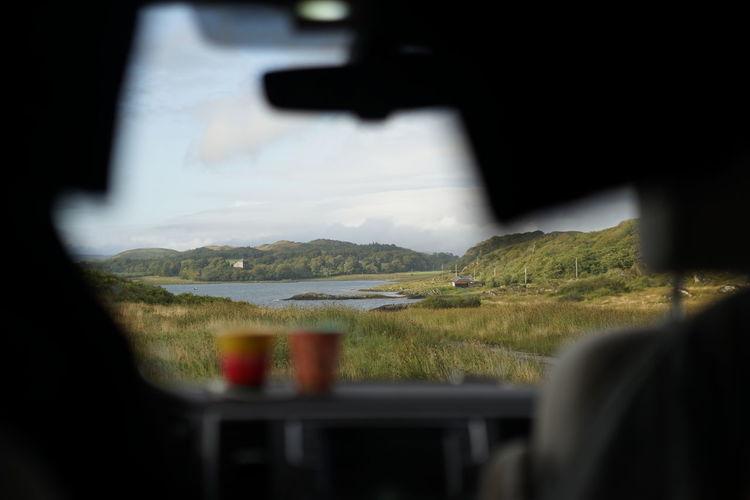 Scenic view of mountain seen through glass window