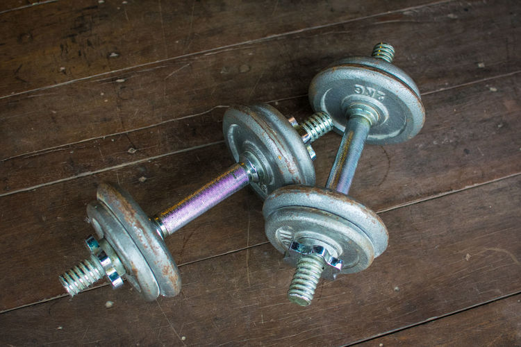 Metal dumbell on wood floor background Body & Fitness BodyBuilder Bodybuilding Exercise Iron Wood Aluminium Architecture Backdrop Background Built Structure Close-up Color Colour Day Dumbbell Electricity  Fit Fitness Floor Gym Health Healthy In Door Indoors  Kilo Light Bulb Low Angle View Metal No People Old Wood Sport Technology