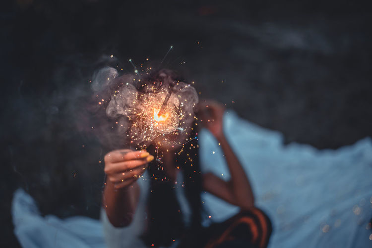 Person holding firework display