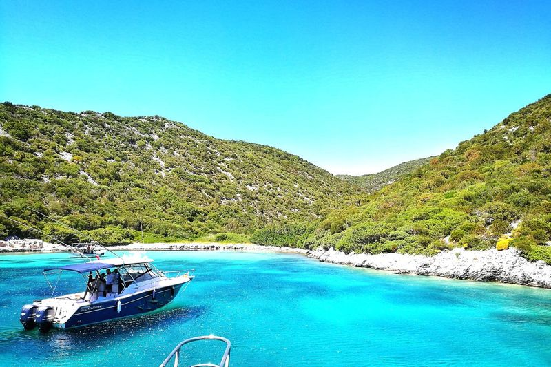 Blue water lagune Water Blue Mountain Nautical Vessel Day Scenics Outdoors Swimming Pool Tranquility Nature No People Summer Beauty In Nature Sky Clear Sky Tree Sea Smartphonephotography Natural Beauty Nature Photography The Great Outdoors - 2017 EyeEm Awards Live For The Story