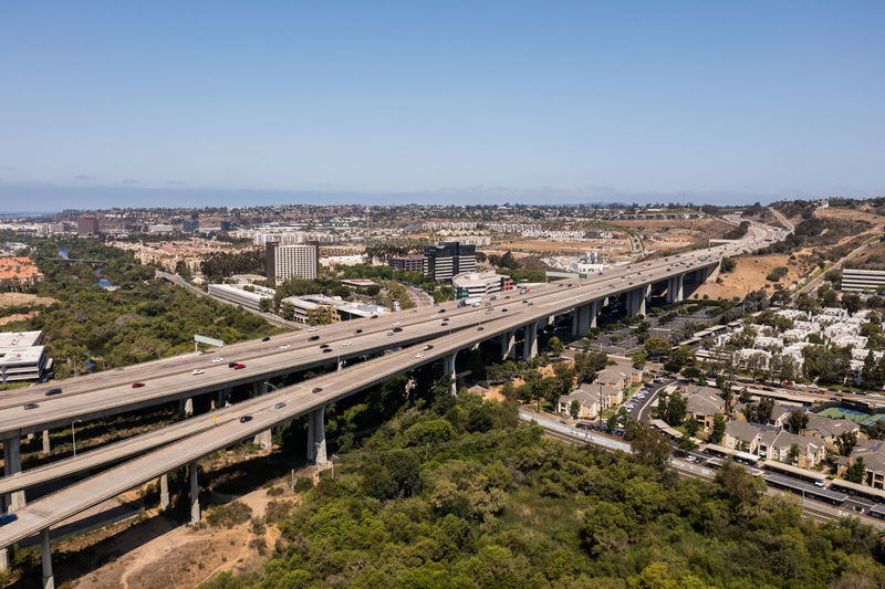 High angle view of elevated road and cityscape against sky