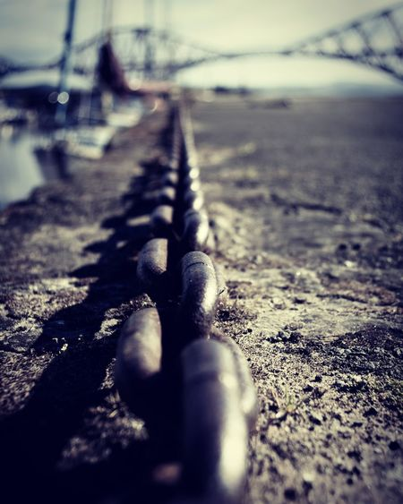 The Chain Chain Construction Water Beach Harbor Shadow Bridge - Man Made Structure Close-up Sky Rusty
