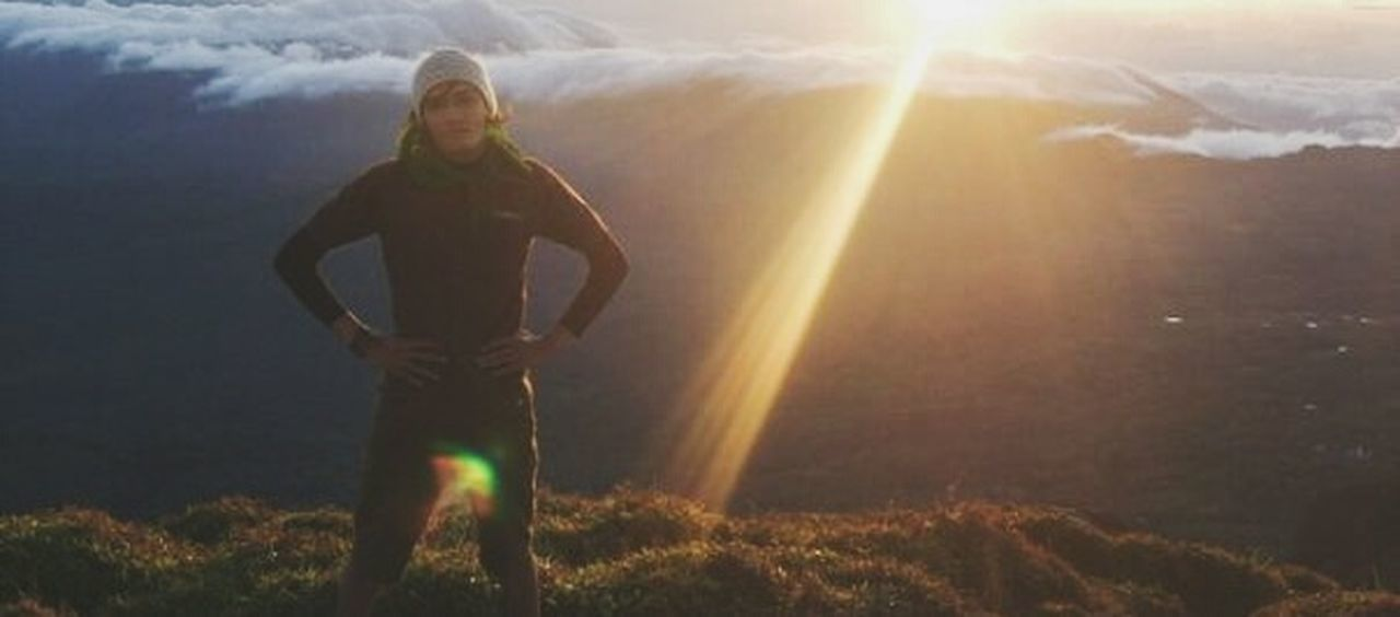 lens flare, adventure, one person, standing, sunlight, sunset, adults only, people, adult, outdoors, one woman only, grass, ethereal, nature, rural scene, only women, forest, young adult, full length, light beam, mountain, portrait, one young woman only