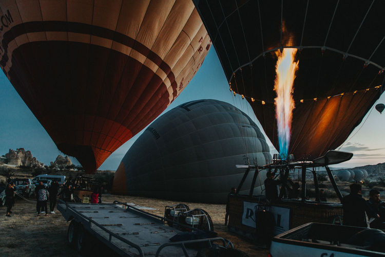 Hot Air Balloon Air Vehicle Group Of People Balloon Transportation Real People Burning Adventure Flame Fire Incidental People Travel Mode Of Transportation Nature Sky Heat - Temperature Fire - Natural Phenomenon People Leisure Activity Day Outdoors Inflating