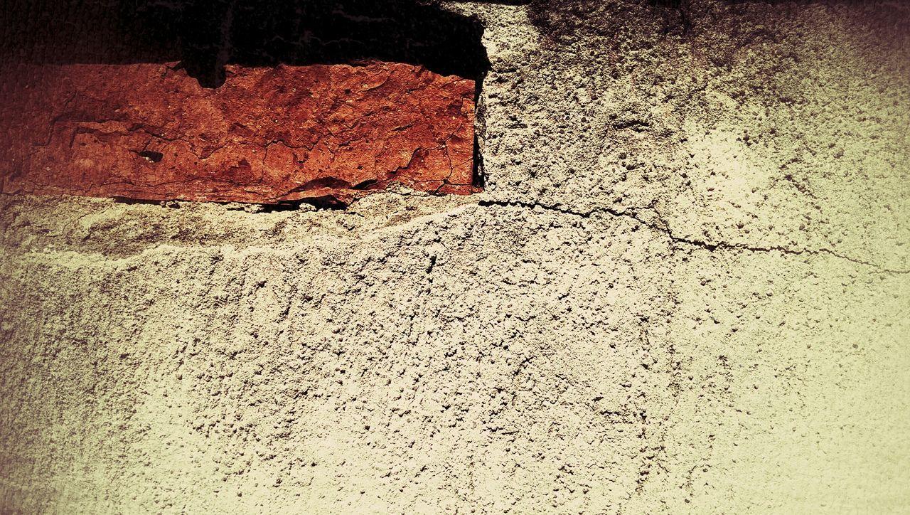 Close-Up Of Brick On Abandoned Wall