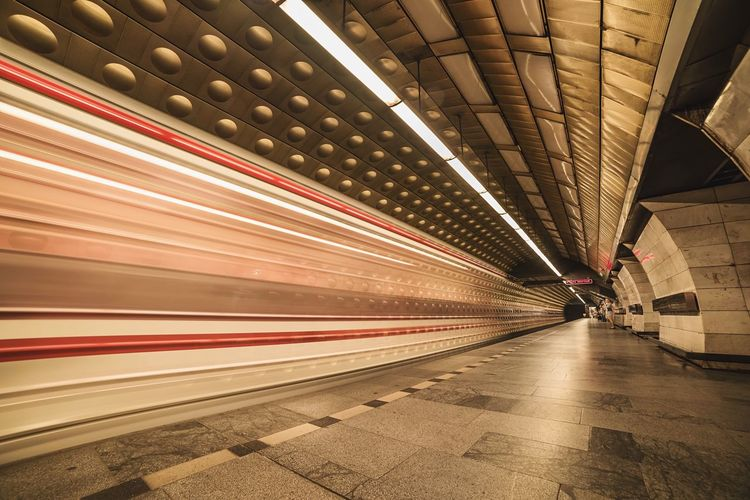 Light trails by train at subway station