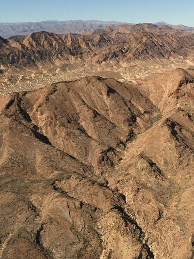Geology Physical Geography Tranquil Scene Beauty In Nature Nature Arid Climate Scenics Non-urban Scene Landscape Outdoors Barren Tranquility Day Extreme Terrain Remote Desert Arid Landscape No People Sky Flying High Textures Of Nevada The Natural World Texture Nature Aerial View
