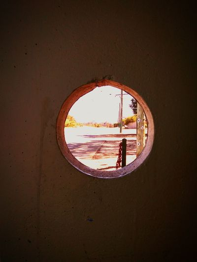 Through the port hole into a new realm Bus Stop Waits Bus