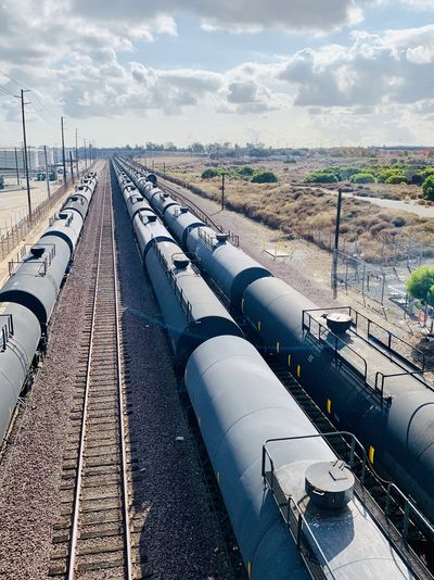 High angle view of freight trains against sky