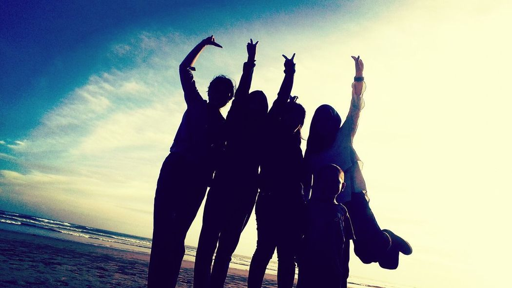 Silhouette Celebration Happiness Togetherness Flowers, Nature And Beauty Styled Stock Photos Beach Group Of People Photography Themes Leisure Activity Young Women Enjoyment Casual Clothing Inspiration Sunset Sky