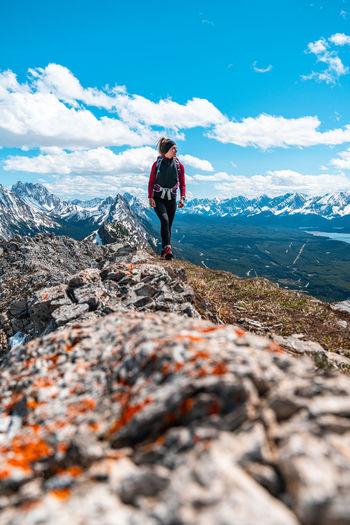 Full length of boy on mountain against sky