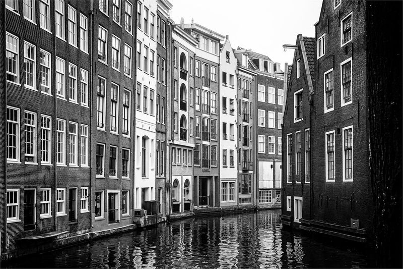 Houses with canal in Amsterdam Building City Canal Water Waterfront Reflection Sky Outdoors House Apartment Row House Architecture Amsterdam Gracht Netherlands Monochrome Black And White Romantic Town Dutch Art Tourism Fineart Europe