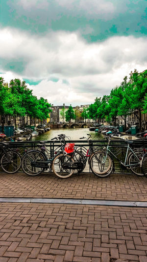 Bicycles parked against sky in city