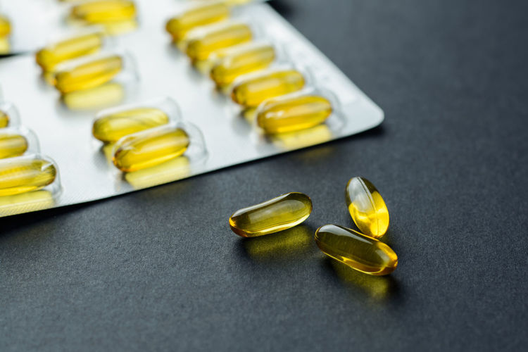 Close-up of cod liver oil capsules on table