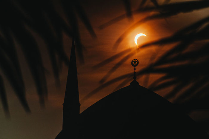 Partial Solar Eclipse, 9th March 2016. 8.24am. Arts Culture And Entertainment Atmosphere Copy Space Dark Glowing Illuminated Imagination Islamic Architecture Low Angle View Masjid Masjid Sultan Salahuddin Abdul Aziz Shah Mosque Mystery Partial Solar Eclipse Silhouette Single Object Solar Eclipse 2016 Landscapes With WhiteWall