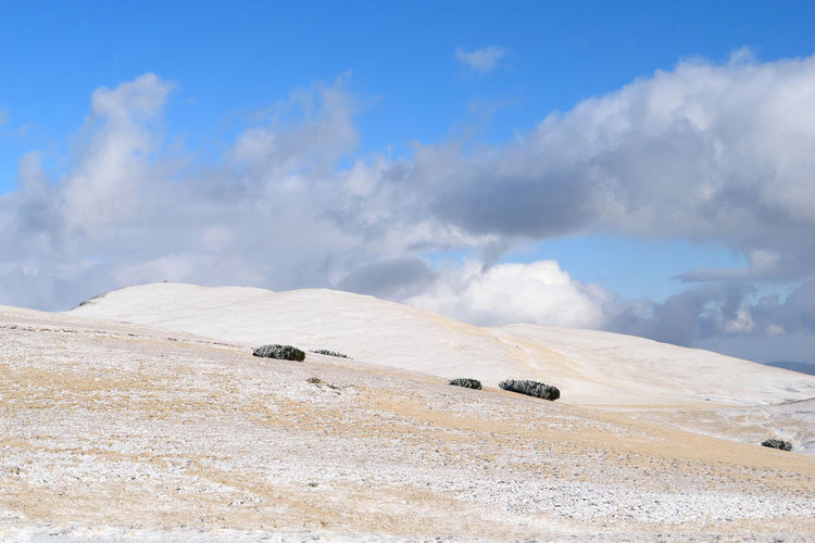 white and blue Romania Shades Of Winter Winter Wintertime Beauty In Nature Blue Cloud - Sky Cold Temperature Day Landscape Mountains Nature No People Outdoors Sand Dune Scenics Sky Snow Tranquil Scene Tranquility White