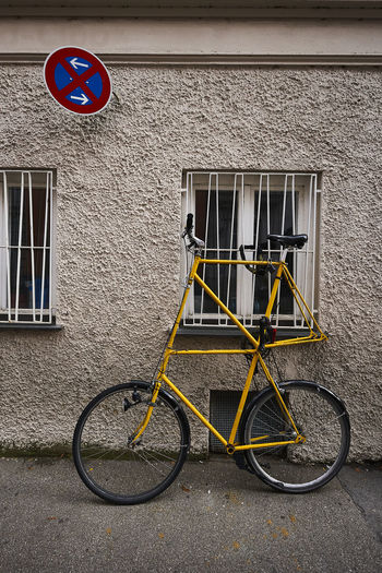 Bicycle sign on road against building