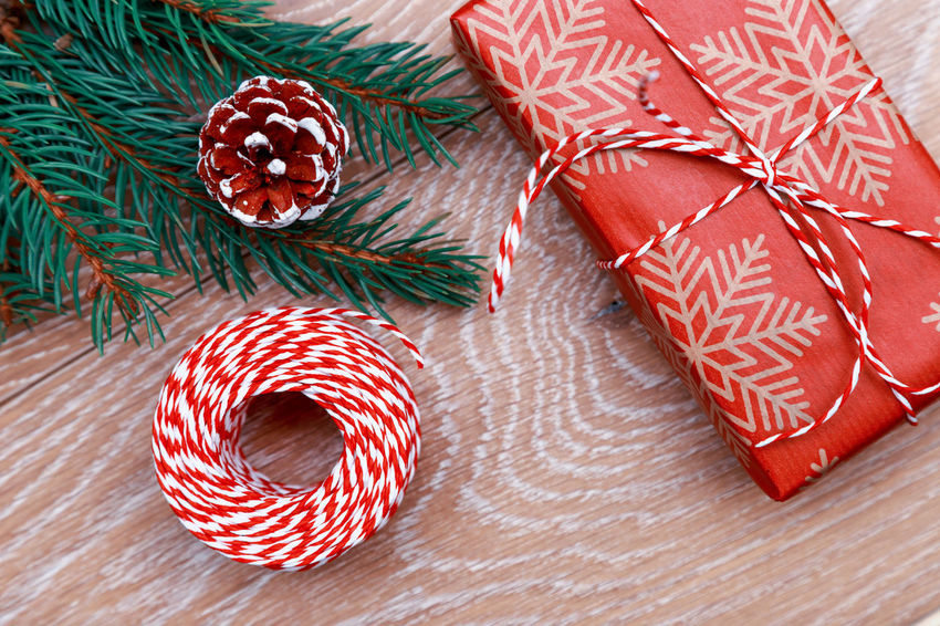 Christmas gift Christmas Around The World Preparation  Christmas Is Coming Flat Lay Tree Branch Christmas Decoration Decor Suprise Box Gift Gift Box New Year Xmas MAS Christmas Surprise Rustic Style Present Wooden Background Ribbon Wrap Rope Christmas Spirit Christmas Time