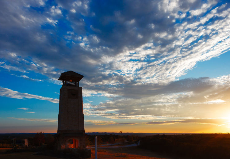 Low angle view of lighthouse against sky during sunset