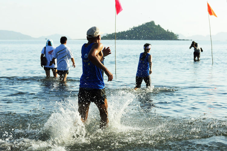 Asian Culture Athlete Beach Chumphon Cross Sea Running Day Funrun Langsuan Traditional Long Boat Racing Festival, Thailand Marathon Runner Ocean Outdoors People Physical Activity Pithak Island Pithak Island Runner Running Sea Sky Sport Street Thai Water Women วิ่งแหวกทะเลสู่เกาะพิทักษ์ Go Higher