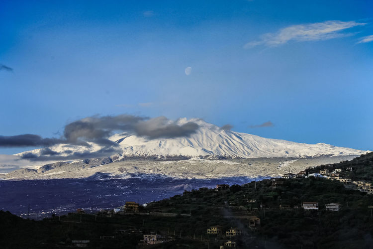 Sky Mountain Cloud - Sky Scenics - Nature Beauty In Nature Environment No People Building Exterior Volcano Landscape Nature Snow Built Structure Architecture Travel Destinations Cold Temperature Day Tranquil Scene Non-urban Scene Land Snowcapped Mountain Outdoors Mountain Peak Volcanic Crater Power In Nature