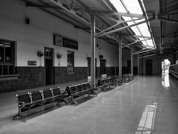 Railwaystation Trip Waiting Area Chair Indoors  Large Group Of Objects No People Built Structure Day Architecture Monochrome Be. Ready. Black And White Friday EyeEmNewHere EyeEm Ready   An Eye For Travel The Graphic City Stories From The City Adventures In The City The Architect - 2018 EyeEm Awards The Traveler - 2018 EyeEm Awards