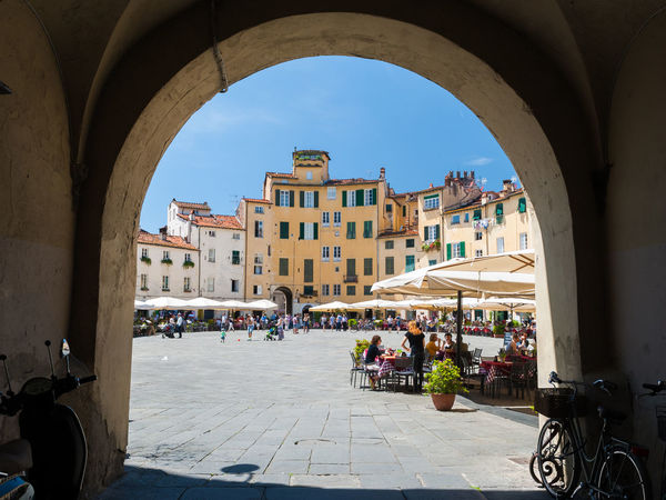 """Glimpse on the """"Piazza dell'Anfiteatro"""", famous square in Lucca City Cityscape Lucca Perspective Square Sunny Toscana Tuscany Anfiteatro Arch Architecture Building Exterior Built Structure City Glimpse Italy Landmark Outdoors People Sky Town Urban"""