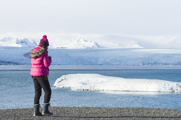 Lady in red shirt walk by the side of Eyjafjallajokull one of the bigger glacier in winter Iceland Eyjafjallajökull Volcano Ice Travel Walk Winter Cold Girl Glacier Lagoon Water Landscape Mountain Tourism Travel Destinations