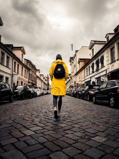 Steps. Architecture Building Exterior City Street Built Structure Sky Cloud - Sky Real People Lifestyles One Person Rear View Women Wet Outdoors Rain