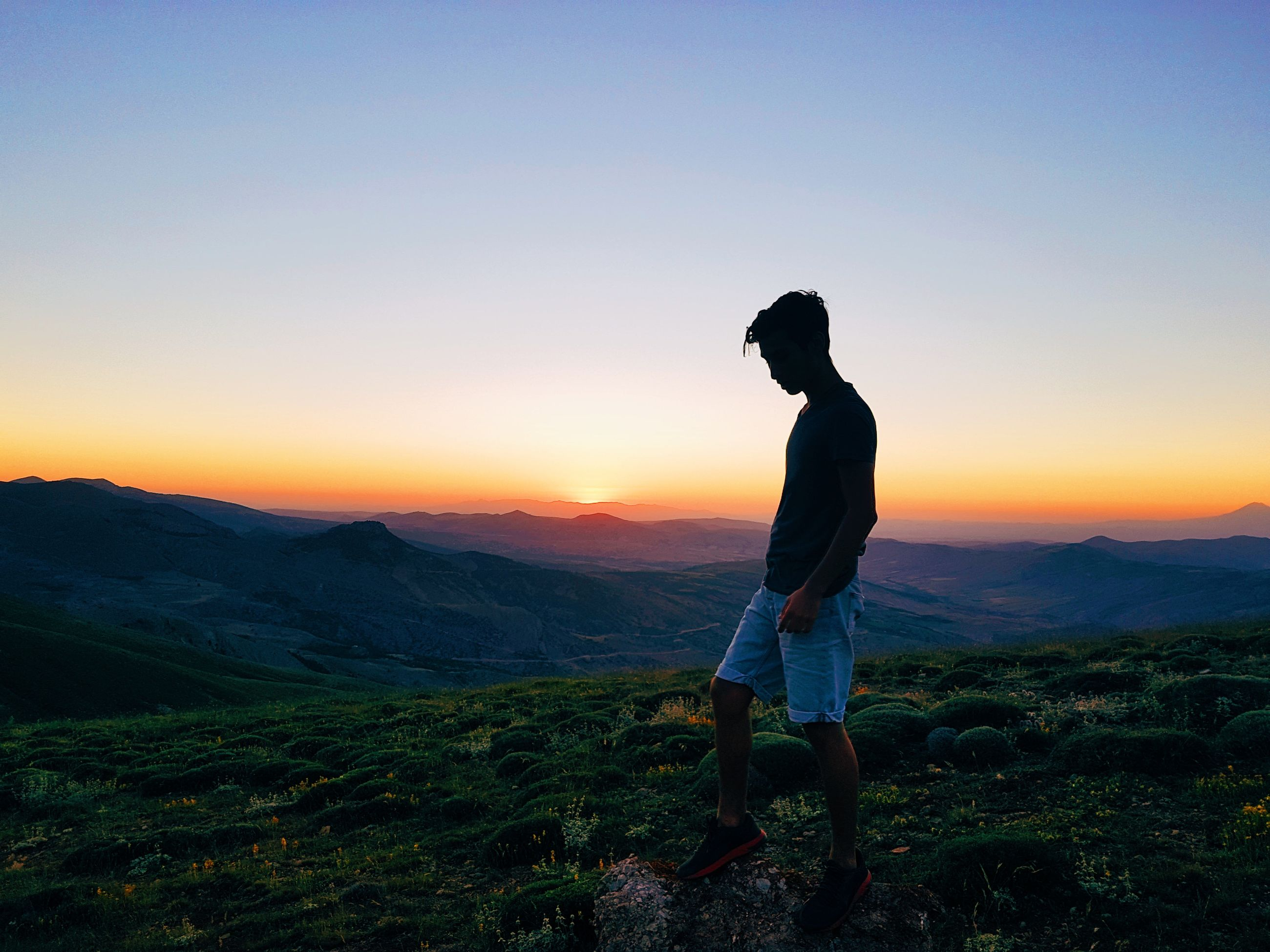 real people, sunset, leisure activity, lifestyles, nature, one person, standing, beauty in nature, casual clothing, scenics, full length, mountain, sky, outdoors, women, landscape, young adult, clear sky, young women, day, people